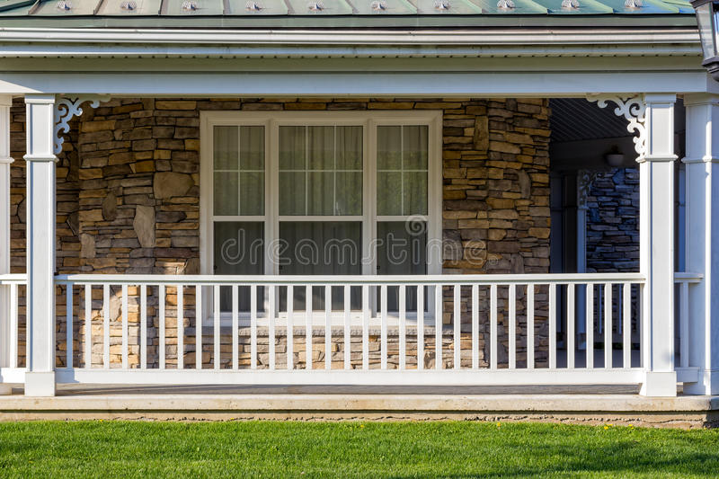 Porch with a white railing royalty free stock photography