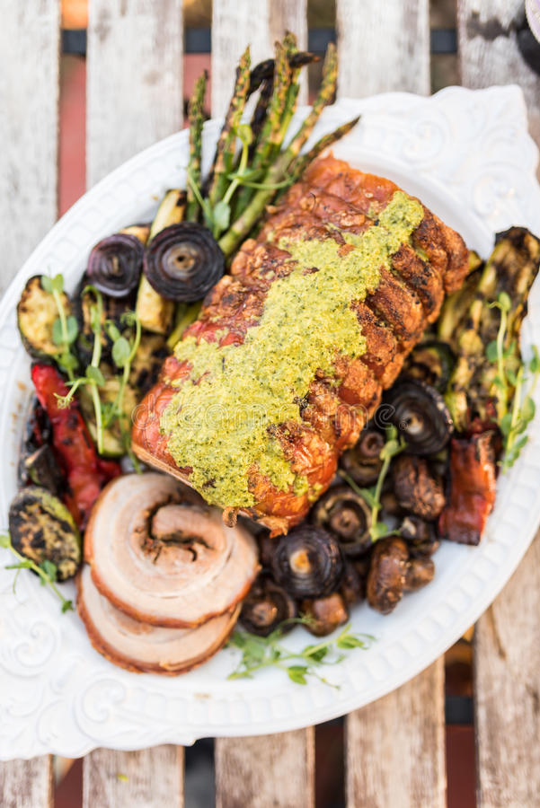 Porchetta with grilled vegetables stock photo