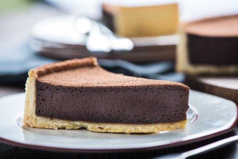 Porción de agravio o de torta del chocolate imagen de archivo libre de regalías