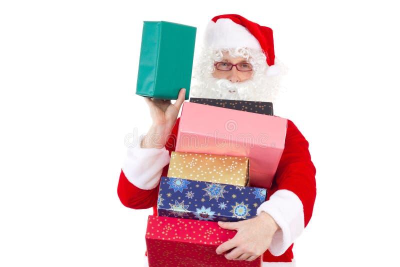 Porción de extensión de Santa Claus de regalos fotografía de archivo
