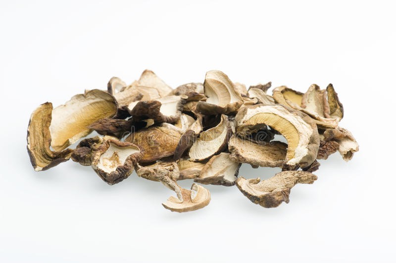 Porcini Mushrooms. A Close-up Of Dried Porcini Mushrooms Against A White Background stock photo
