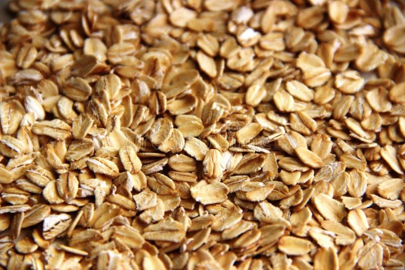 Porciones de escamas de la harina de avena o de la avena como fondo la avena útil del concepto forma escamas gluten libre imagen de archivo libre de regalías
