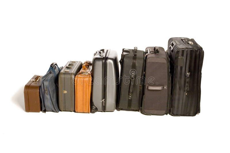 Porciones de maletas que viajan fotos de archivo