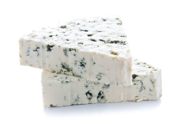 Porciones del queso verde imagenes de archivo