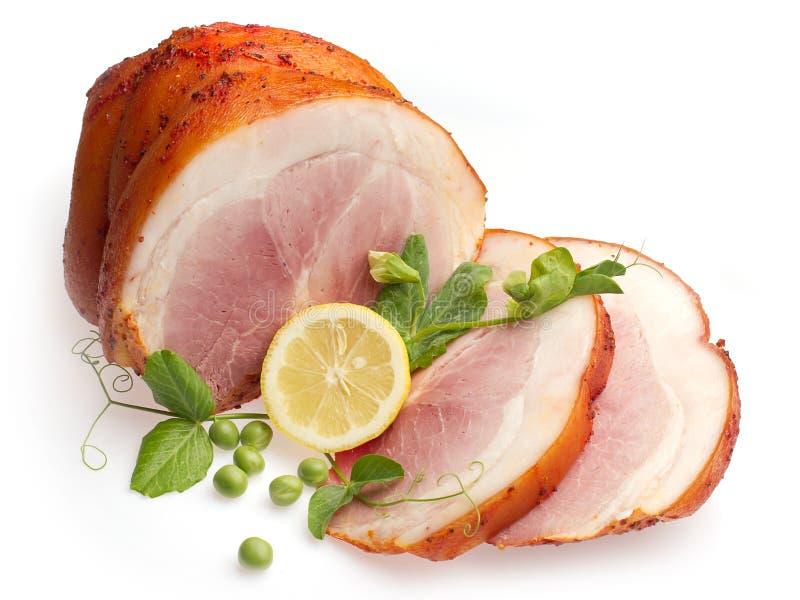 Porco bollito freddo decorato con il limone ed il pisello fotografia stock