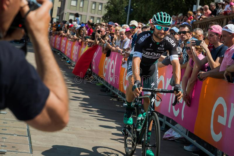 Pordenone, Italy May 27, 2017: Professional cyclist of the Bora Hansgrohe team, transferring from the bus to the podium signatures royalty free stock image