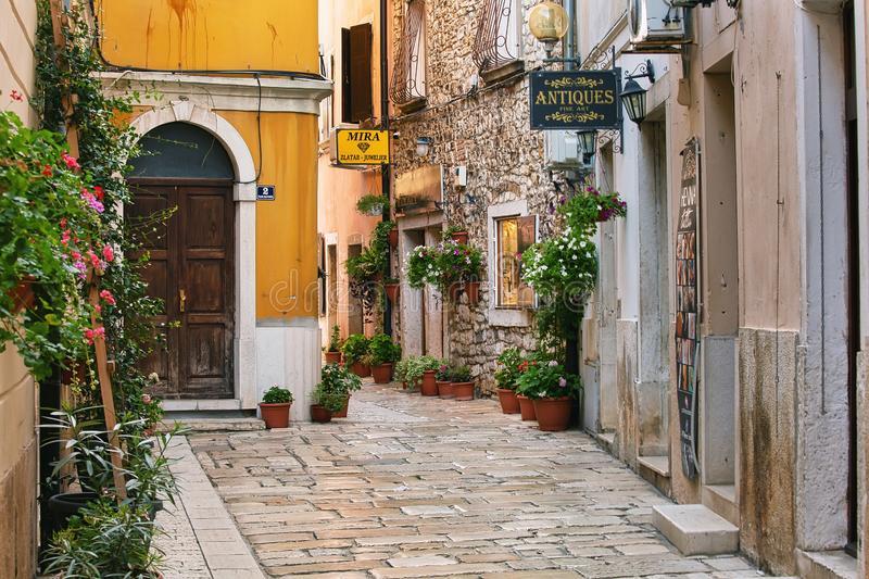 POREC, CROATIA - August 8th, 2019: Empty street of old town early in the morning. POREC, CROATIA - August 8th, 2019: Empty street of historic old town early in royalty free stock photography