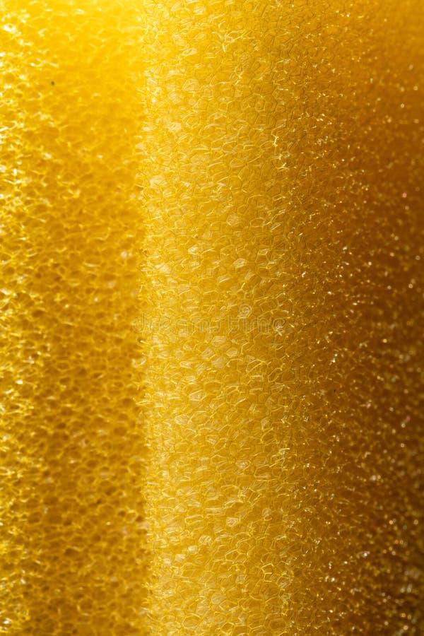 Poreuze textuur van spons Geel poreus sponsmateriaal Schuimrubbertextuur royalty-vrije stock foto's