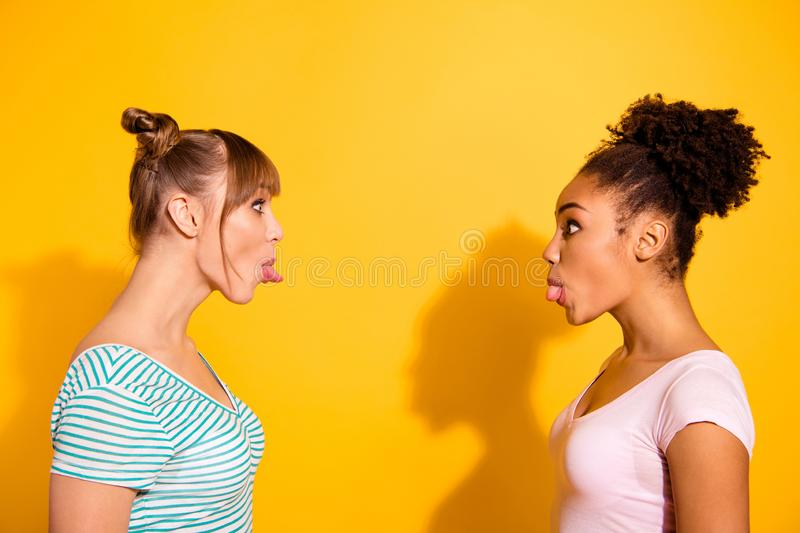 Porfile side view photo funny cute attractive teen teenager childish carefree rest fool make faces way curly hairdo. Style stylish trendy shadow top-knot summer stock photos