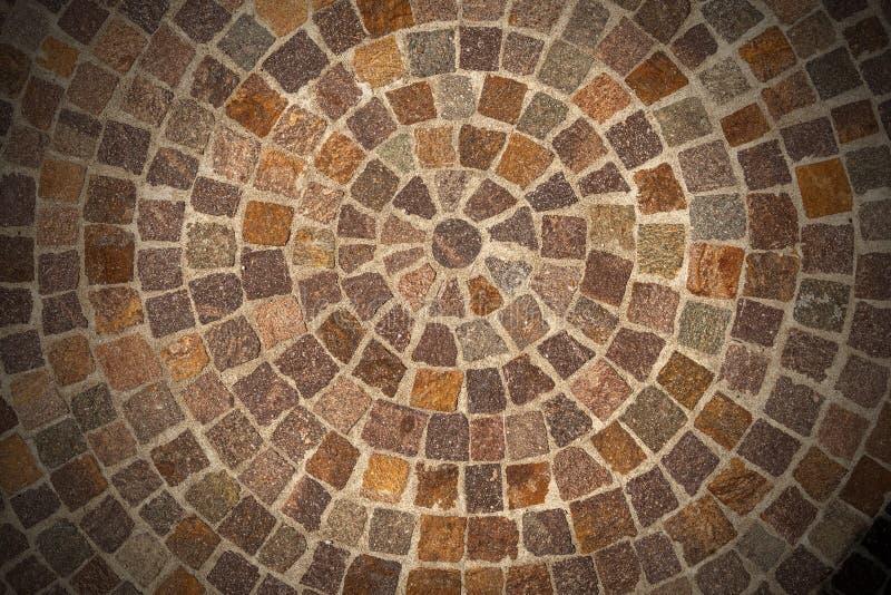 Porfyr stenar golvet kallade Sanpietrini eller Sampietrini arkivfoto