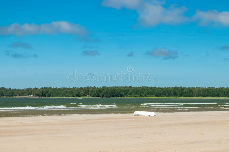 Pori, Finland - 27 June, 2019: Lifeboat on beautiful sandy beach Yyteri at summer, in Pori, Finland.  royalty free stock photography
