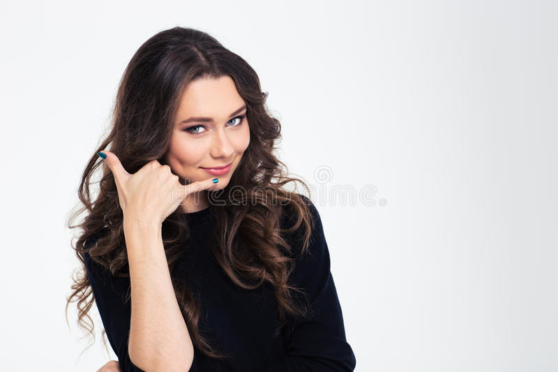 Poritrait of a beautiful woman showing sign to call me royalty free stock photography