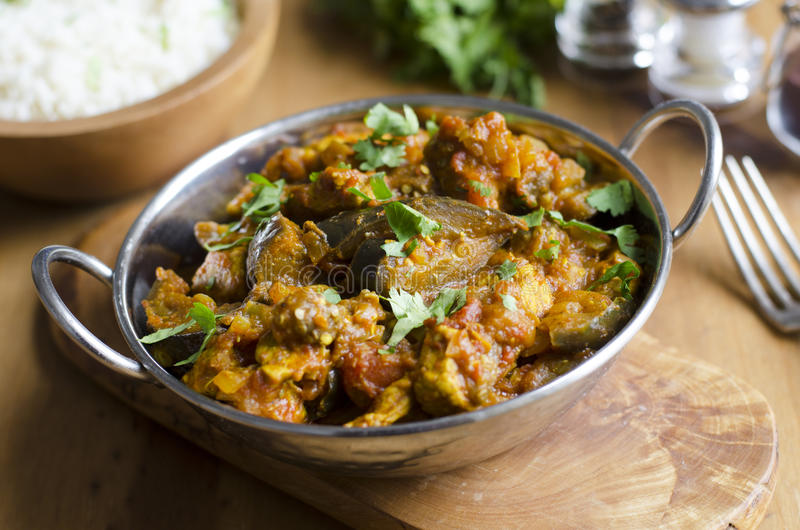 Pork and aubergine curry. Pork curry with aubergine and red lentils royalty free stock photo