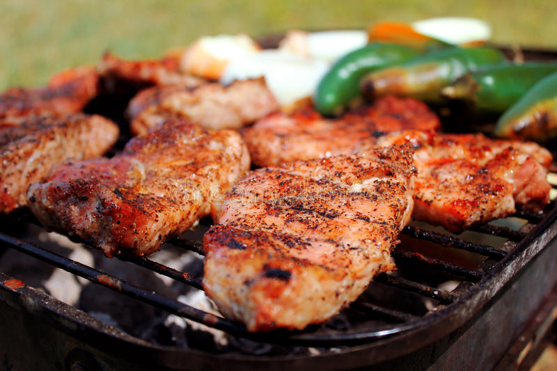 Pork barbecue. Roasted barbecue in the summer stock images