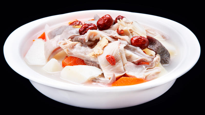 Pork bellies, red jujube, papaya, HuaiShan soup, Chinese traditional cuisine isolated on black background stock images