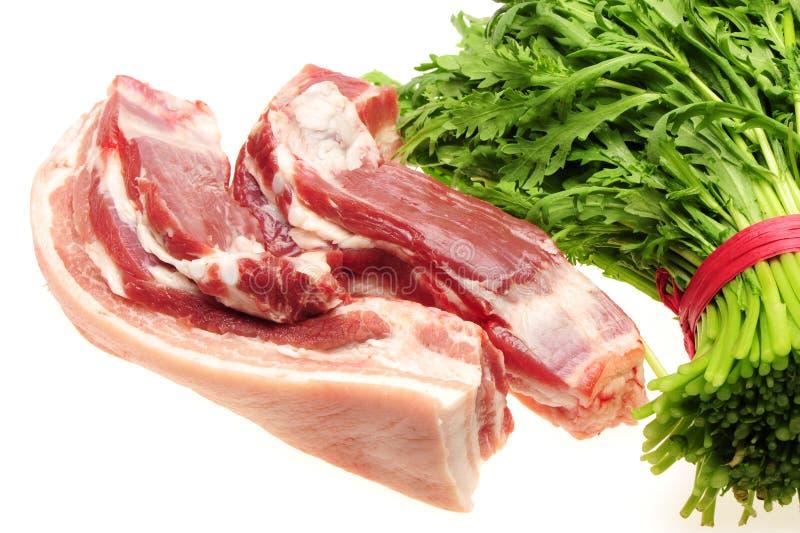 Pork belly and Fresh Edible Chrysanthemum coronarium royalty free stock photos