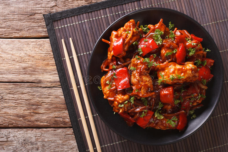 Pork braised in sweet and sour sauce with vegetables close-up. H royalty free stock photography