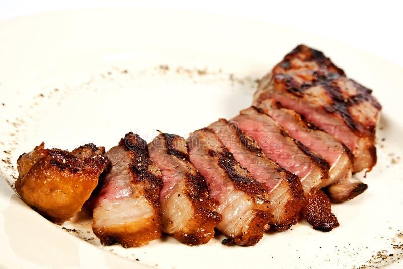 Pork brisket. Grilled pork brisket with spices royalty free stock photography