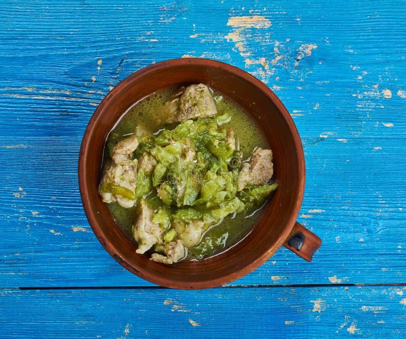 Pork Chili Verde. Southwestern-style chili , Pork slowly stews with jalapenos, onion, green enchilada sauce royalty free stock images
