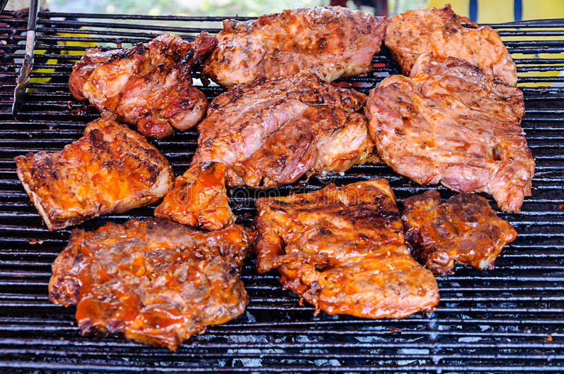 Pork chop grilled. On the grill stock photo