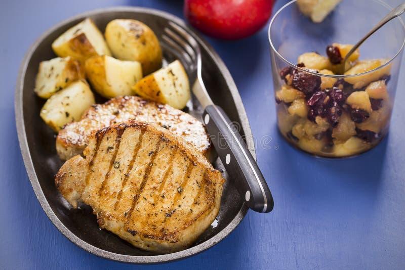 Pork chops with apple chutney royalty free stock photo