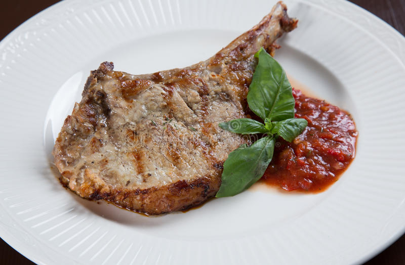 Download Pork chops with BBQ sauce stock photo. Image of grill - 25491498