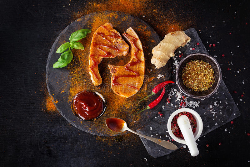 Pork chops with spices stock photography