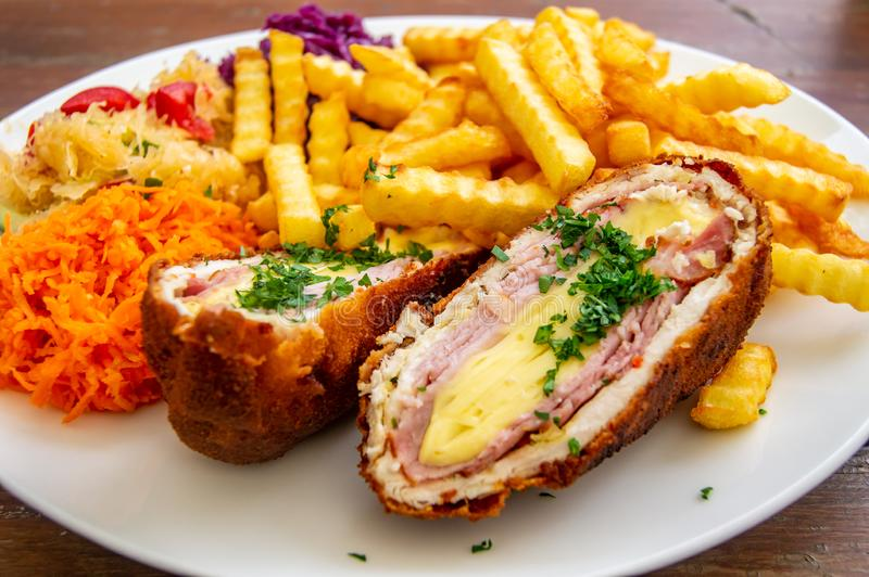 Pork Devolay. chop de volaille, chicken breast, chicken meat with cheese, French fries, salads royalty free stock photo