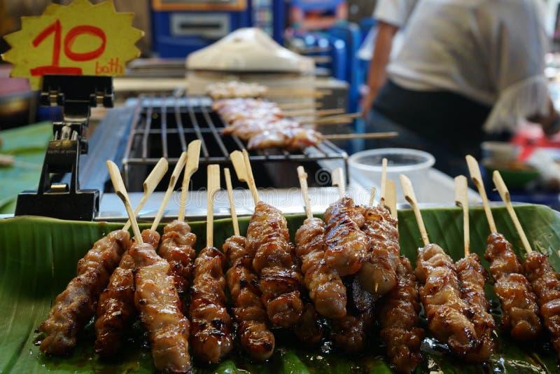 Pork grill on bamboo stick. Street food stock photos