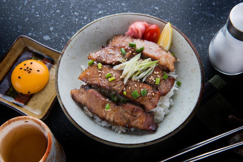 Pork grill on rice or Buta Yaki don. Pork grill on rice or Buta Yaki don in Japanese street food style stock image
