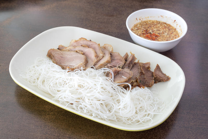 Pork grilled with rice noodle,Vietnamese typical cuisine. On table royalty free stock image