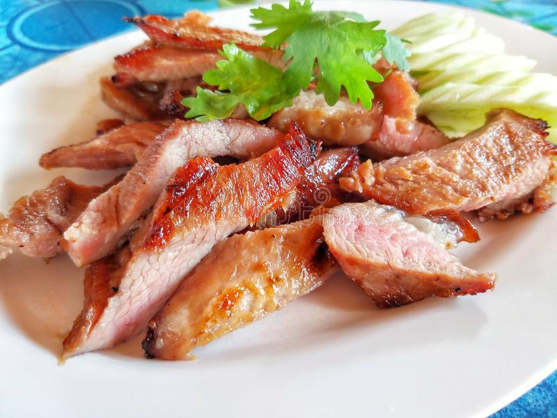 Pork grilled and vegetables. On white dish stock photo