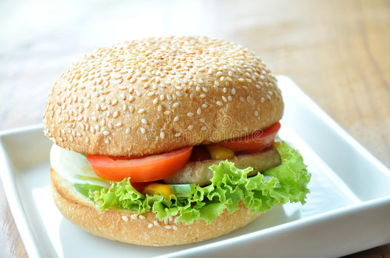 Pork Hamburger. Hamburger (also called a hamburger sandwich, burger or hamburg) is a sandwich consisting of a cooked patty of ground meat usually placed inside a royalty free stock image
