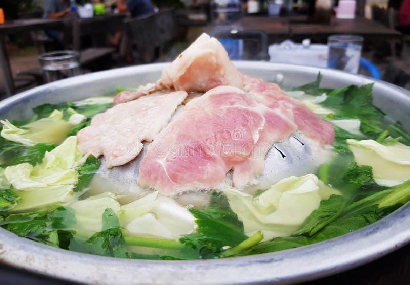 Pork hot pan for dinner. Grill slices of pork on hot pan for dinner stock photo