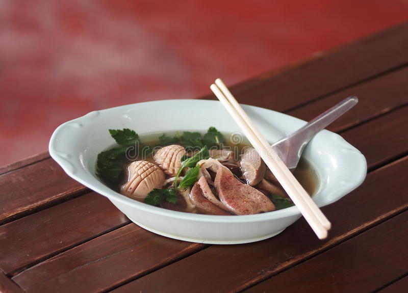 Pork internal hot clear soup with blood jelly THAI and CHINESE menu royalty free stock photo