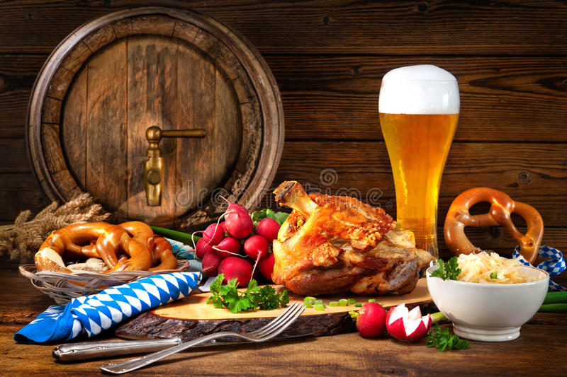 Pork knuckle with beer and sauerkraut. Oktoberfest royalty free stock photos