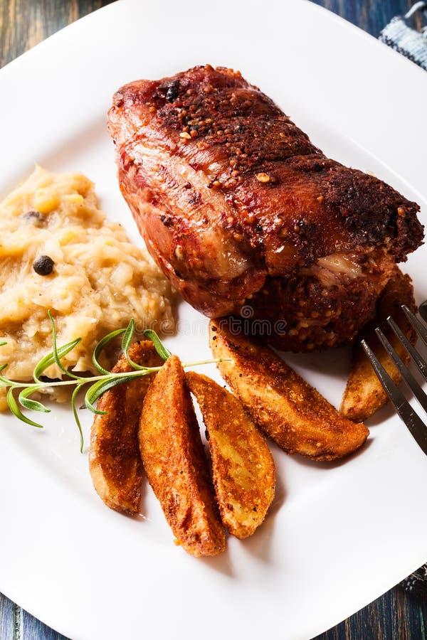 Pork knuckle with fried sauerkraut stock photography