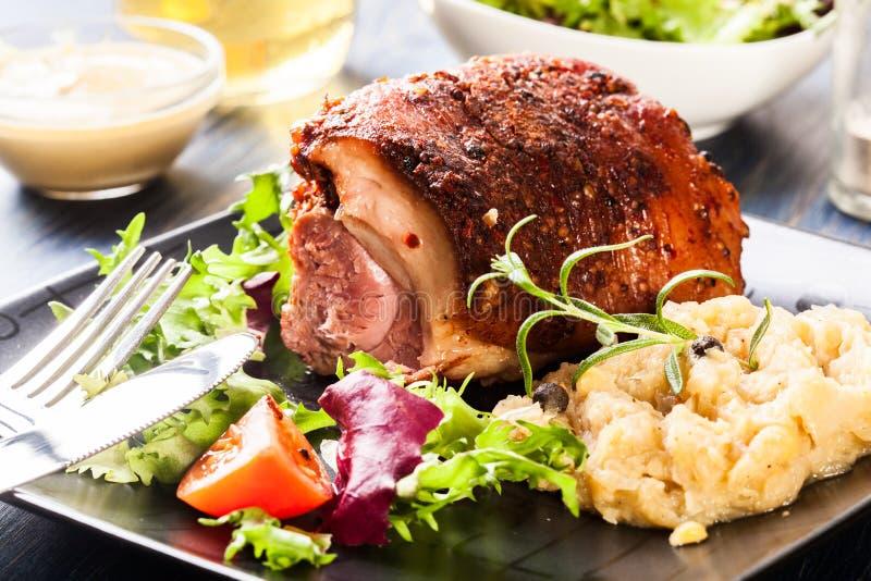 Pork knuckle with fried sauerkraut royalty free stock photos
