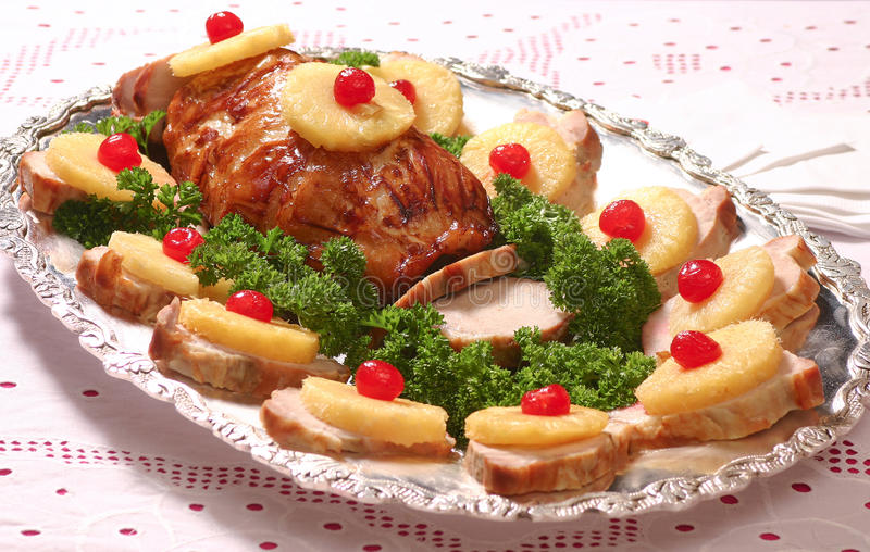 Pork Loin. Tropical roasted pork loin sliced on a tray royalty free stock images