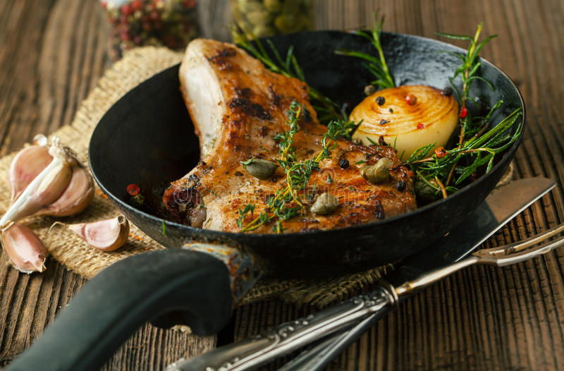Pork loin fried. With spices stock photography