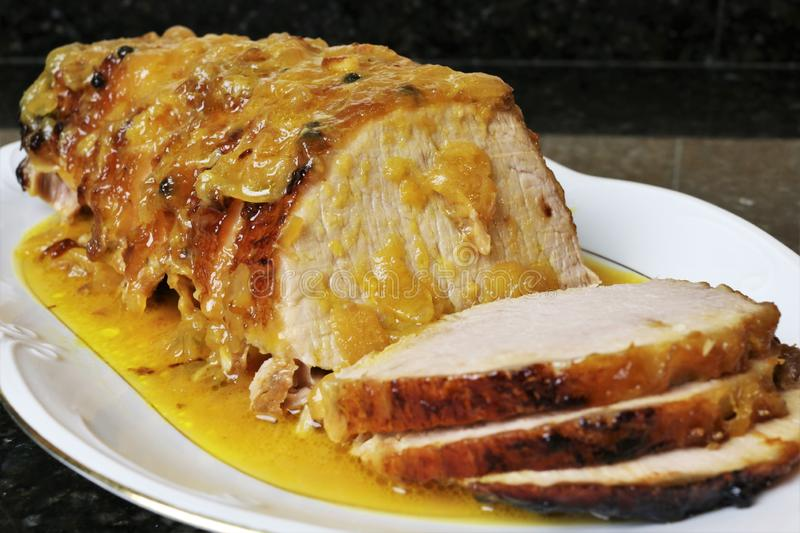 Pork loin meat in orange sauce royalty free stock images