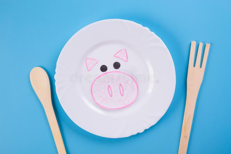 Pork meat on the plate. Cartoon styled stock images