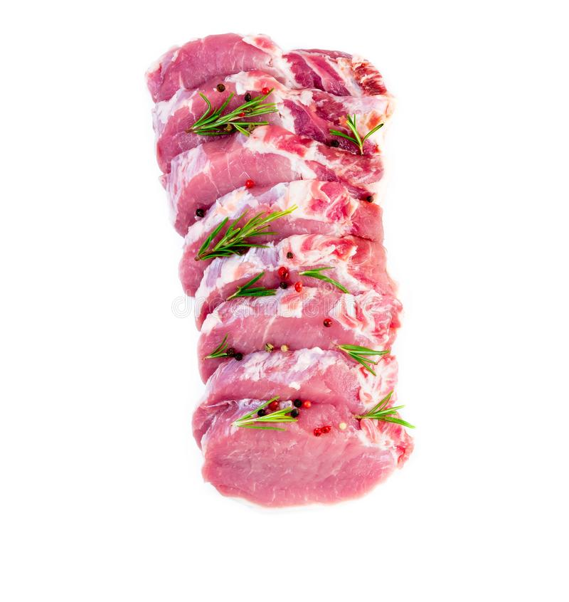 Pork meat slices loin with seasoning on white background, top vi royalty free stock photos