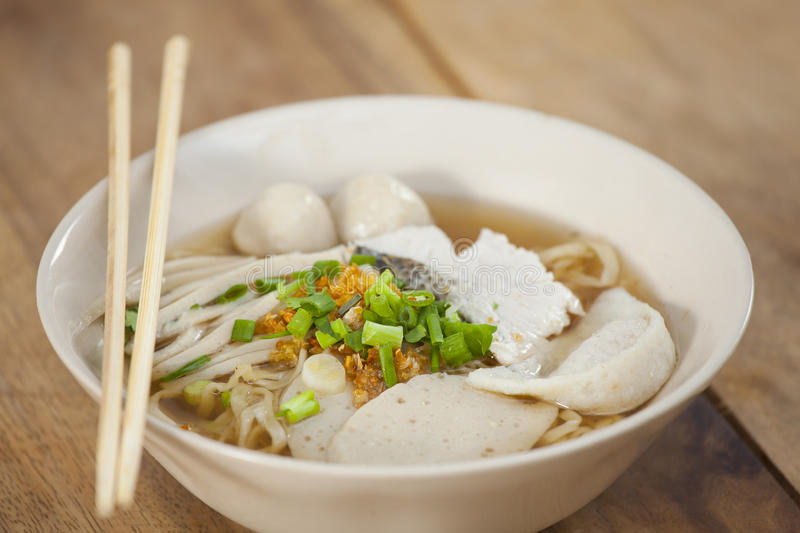 Pork meatballs and steam fish in noodle soup. Thai style stock photo