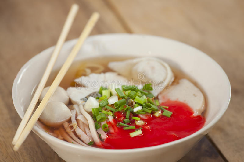 Pork meatballs and steam fish in noodle soup. Thailand stock photos