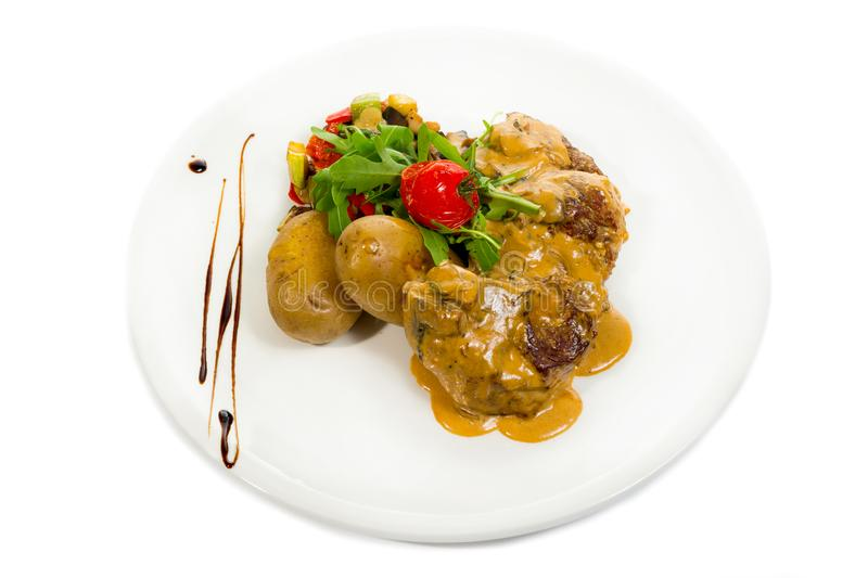 Pork Medallions with Potato and Mushrooms royalty free stock image