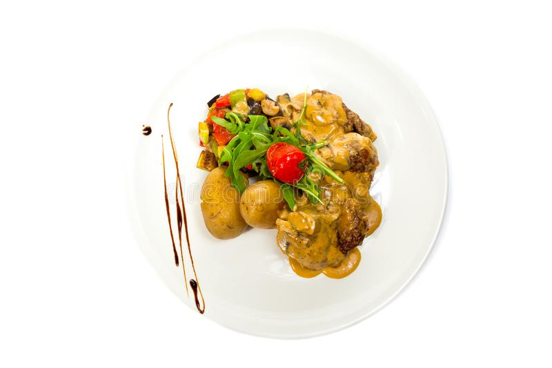 Pork Medallions with Potato and Mushrooms royalty free stock images