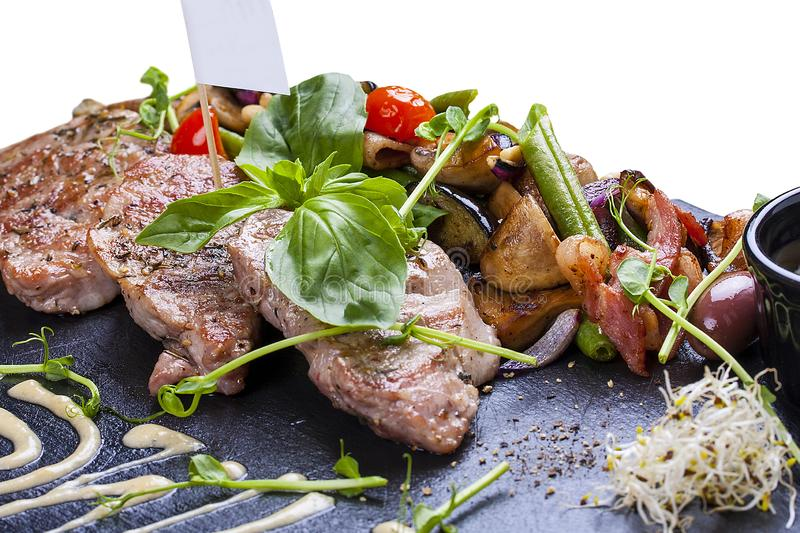 Pork medallions with roasted vegetables royalty free stock photos
