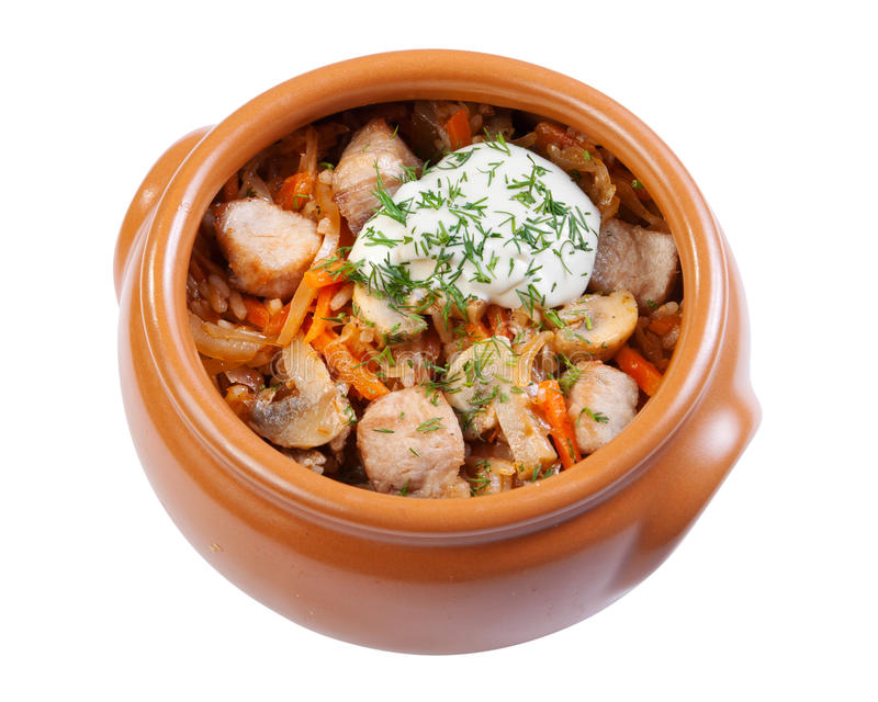 Pork with mushrooms, carrots and onions in a ceramic crock pot,. Isolated on white stock images