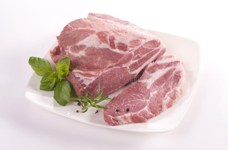 Pork neck. Raw pork neck on white royalty free stock images